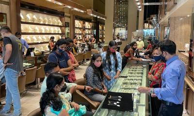 Customers sitting inside Batukbhai Sons Jewellers showroom post Covid lockdowb