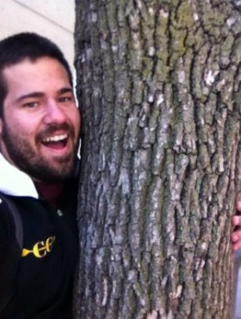 Eric hugs a tree on Earth Day outside the Bookstore.