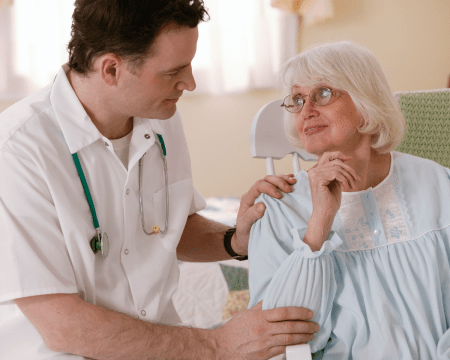elderly lady that's being cared for by a home healthcare assistant