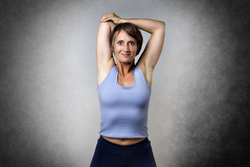 42450828 - middle aged handsome woman doing a stretching exercise