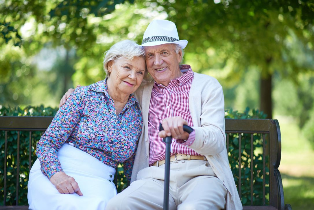 48109989 - romantic senior couple relaxed on the park bench