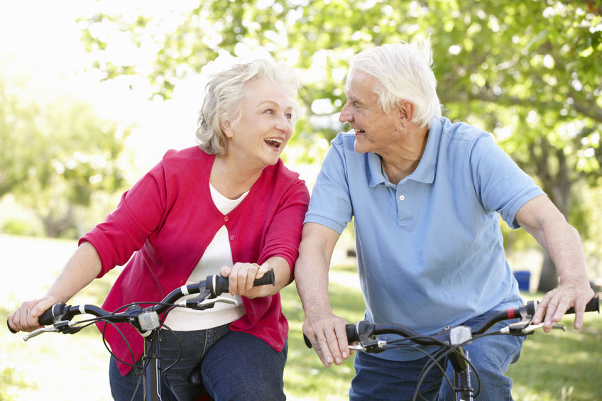 42109116 - senior couple riding bikes