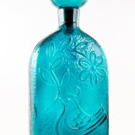 Stunning color from the days of peace and love. A beautiful dark blue called 'Peacock' by mid 20th century glass makers. The color is reminiscent of the stunning blue seen in peacock tails.