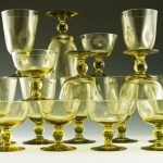 16 piece set of mid-century era pinch goblets in chartreuse, a lemony olive green.