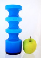 Inner layer is milk white, outer layer is blue, producing a soft blue with color intensity varying according to the thickness of the glass