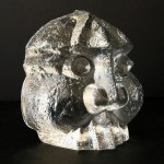 1960's Skrufs Glasbruk glass stylized head paperweight, signed & numbered.