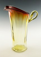 Exceptionally beautiful hand-blown full-size pitcher in vertical optic dual colored glass with stylized applied handle.