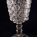 Brilliant old EAPG goblet with deep intricate pattern and domed square foot.