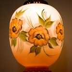 This vintage glass swag lamp is large and in perfect condition. The peach flowers were hand-painted in warm browns, oranges and yellows with black and cream stamen.