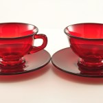 Ruby glass cup and saucer set includes two round saucers and two cups. Original Viking part #797.
