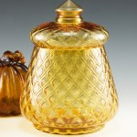 Beautiful Fenton Art Glass canister with lid made between 1962 and 1964. The original part no. is 1780 and the pattern was called 'Candies'.