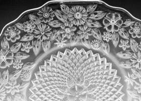 Depression glass Pineapple and Floral dinner plates by Indiana Glass. The colorless Pineapple and Floral items were made in 1932 to 1937.
