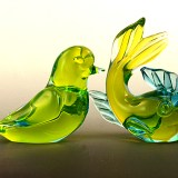 Matching set of vintage Murano glass figurines in vibrant yellow and blue hand-formed glass.