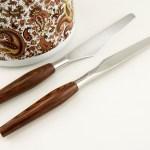 Nice hardwood handles with burlwood type grain on this Danish Modern Cutlery Set.