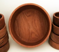 The teak table service set is made from beautiful teakwood with an interesting grain and is well-preserved.