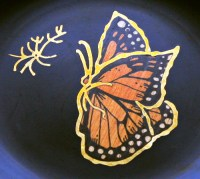 The inlaid wood and brass butterfly dishes are made of satin black Phenolic, impervious to alcohol and boiling water.