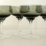 Quality crystal cocktail stemware by Sasaki, Japan. Pattern is called 'Coronation'. Set of 4 smoke black bowls with applied crystal twisted stem.