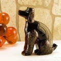 Poodle desk accessory holds a letter, pen, and paper clips.