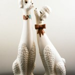 Retro modern 1960's tall ceramic poodles in like new condition.