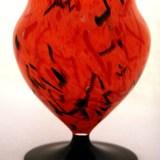 Beautiful Art Deco era cased glass footed vase with a confetti decor.