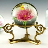 Beautiful large glass paperweight globe with encased glass flower and butterfly.