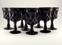 Perspective pattern heavy black glass goblets made in Japan. Production began in 1969 and ended in 1985. Noritake still exports glassware, but it is modern colorless glass.