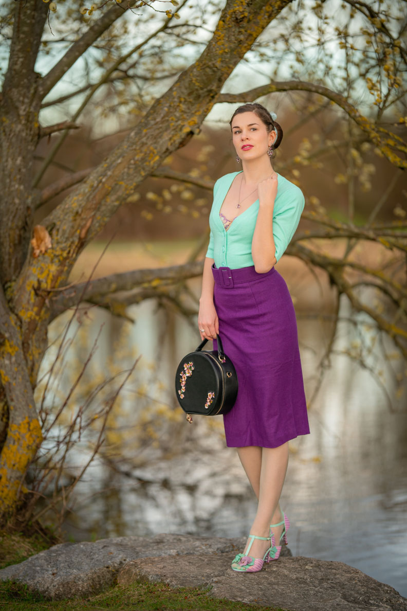 RetroCat wearing a lilac skirt and mint green stockings