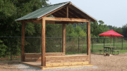 Mother Mathilda Beasley dog park shelter is composed of to-be-discarded materials, including timbers, flooring and metal roofing