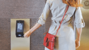 A PORT card reader device identifies personalized passenger information and selects the elevator that will provide the most efficient route to passenger destinations.