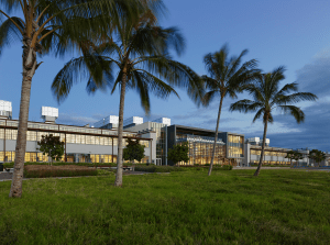 The National Oceanic and Atmospheric Administration's Inouye Regional Center, Pearl Harbor, Oahu, Hawaii, is a renovation of two WWII hangars. The glass section in the center is a new connector piece.The skin on the hangars had to be replaced because of asbestos and other contamination, but the new construction reflects the prior building conditions.PHOTO: Alan Karchmer