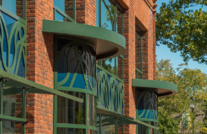 The ornamentation on a new building was inspired by the roof rake boards in the Bedford Building (photo above).