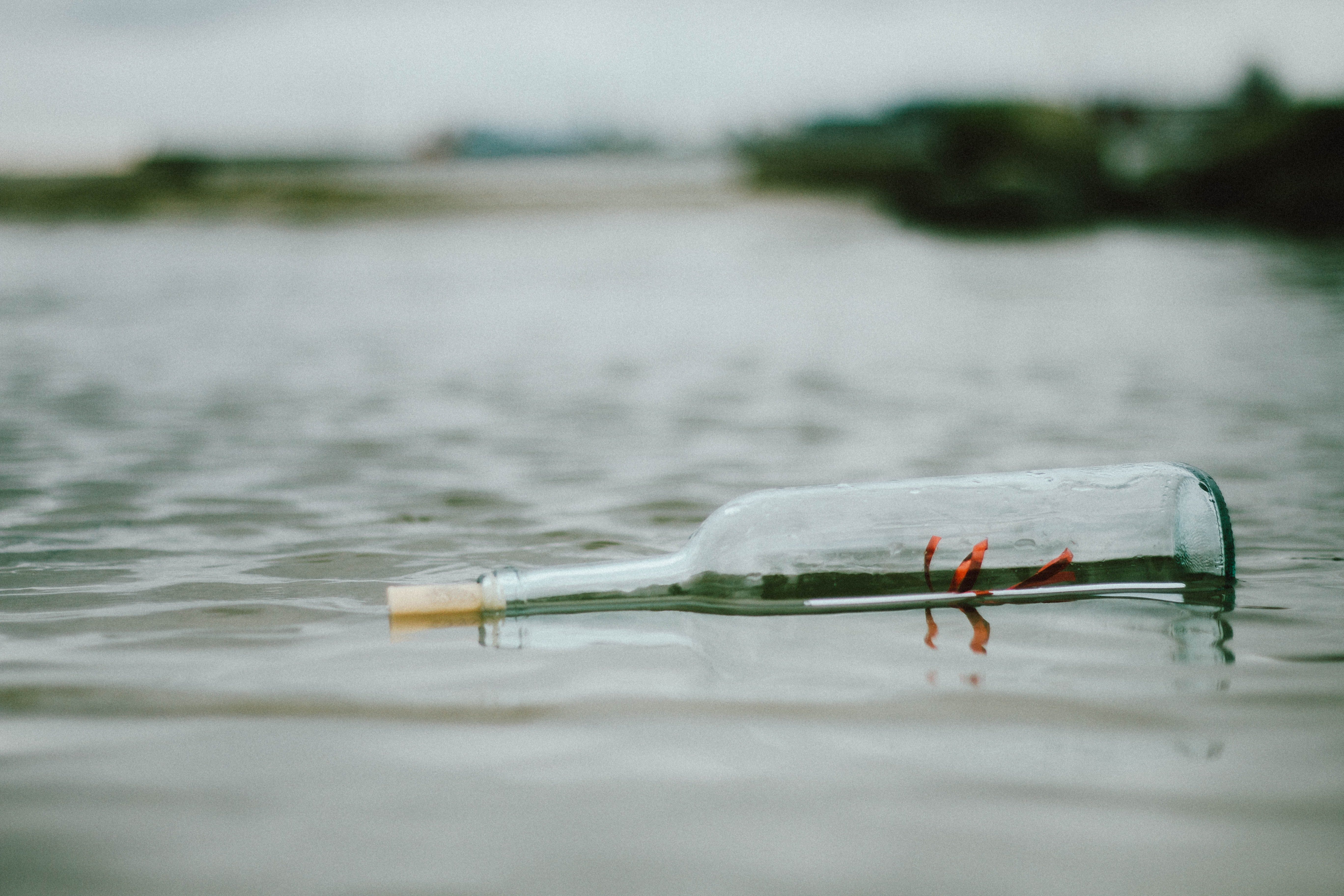 selective-focus-photo-of-bottle-floating-on-body-of-water-1603933