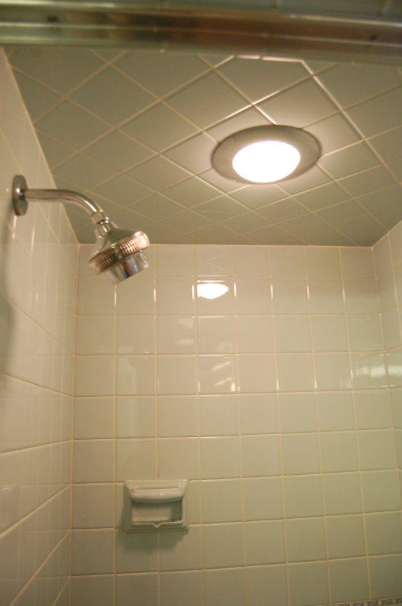A 1964 blue bathroom with builtin HallMack NuTone
