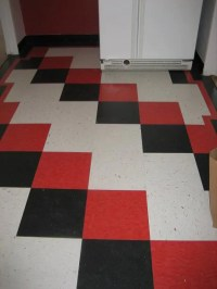 Suzanne's cheery red, black and white checkerboard floor
