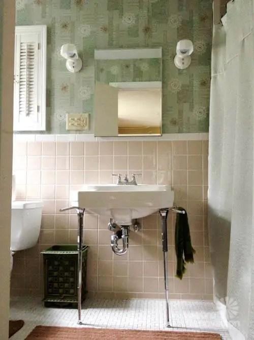 New vintage wallpaper and lighting for Pams bathroom