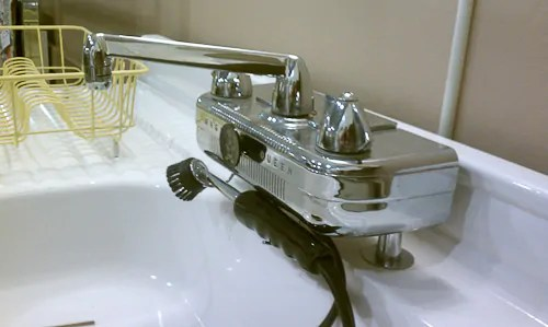antique kitchen faucets complete cabinet set cullen s vintage dishmaster faucet installed retro magic queen