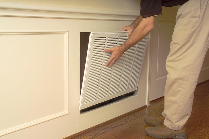 removing old return air grille in preparation for