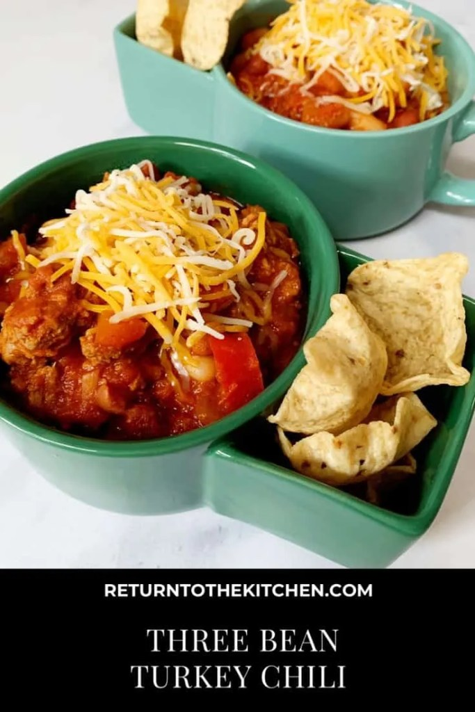 Three Bean Turkey Chili topped with cheese and served with tortilla chips
