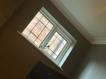 Picture of window with a view of brick wall