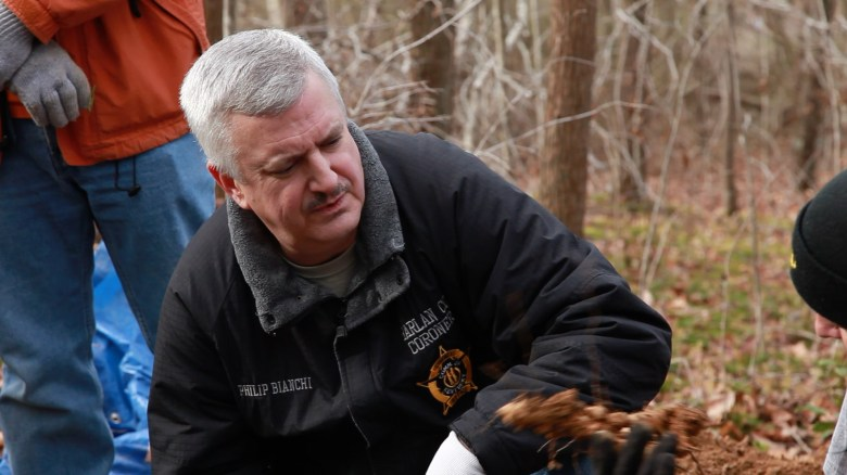 Philip Bianchi, Harlan County, Ky.'s elected coroner, is seen graveside at the exhumation last November.