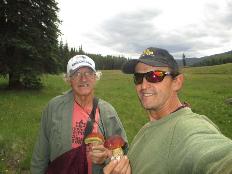 "Keith Davis and his father, John, shown in Arizona's White Mountains, traveled around the globe together. ""Me and him talked about everything. We were best buds,"" John Davis said."