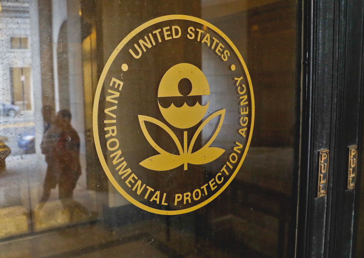 The logo for the EPA is seen on a glass door.