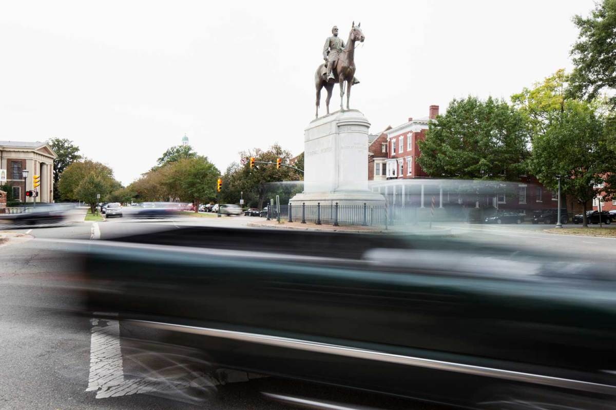 A statue of Thomas Jonathan Stonewall Jackson has the Confederate general sitting astride a horse. The monument stands in the middle of an intersection.