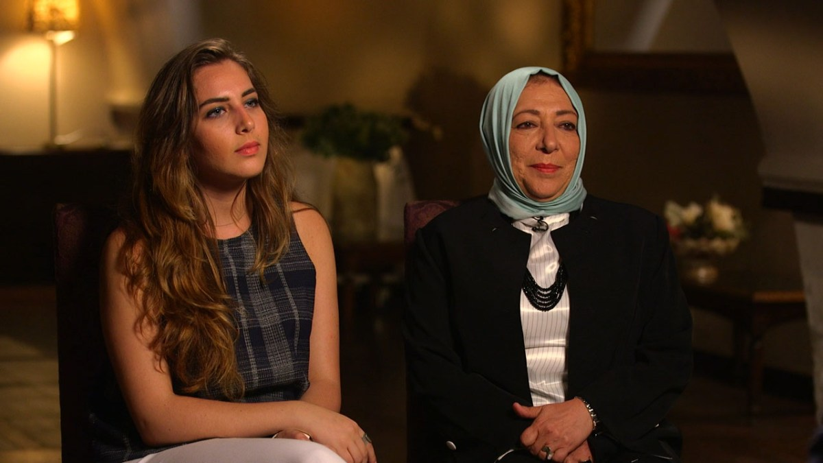 Halla and Orouba Barakat are seated side by side for a formal television interview.