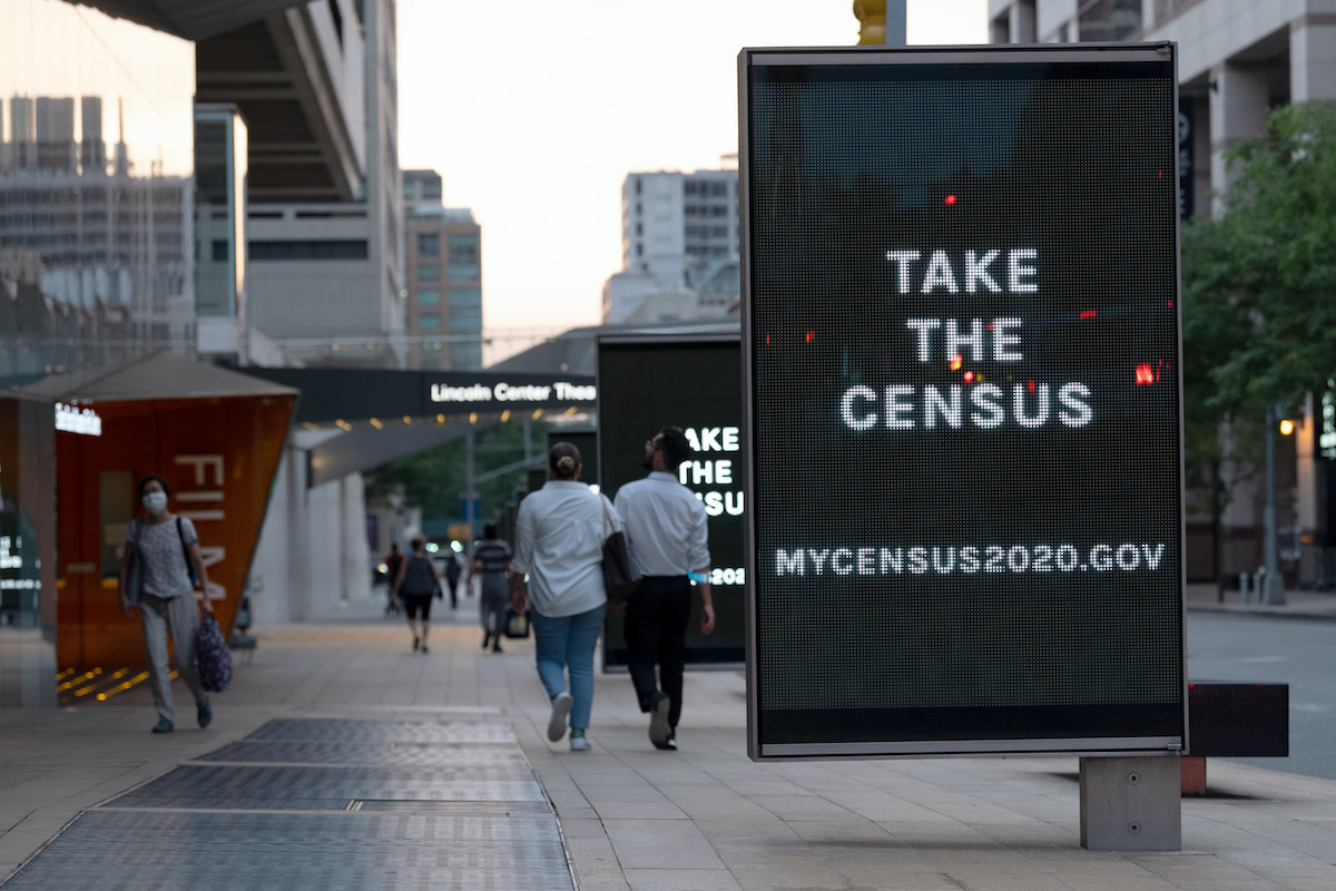 Digital billboards encourage people to fill out their census questionnaires in September at the Lincoln Center for the Performing Arts in New York.