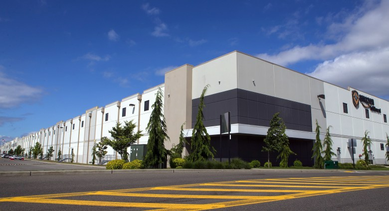 The exterior of an Amazon warehouse