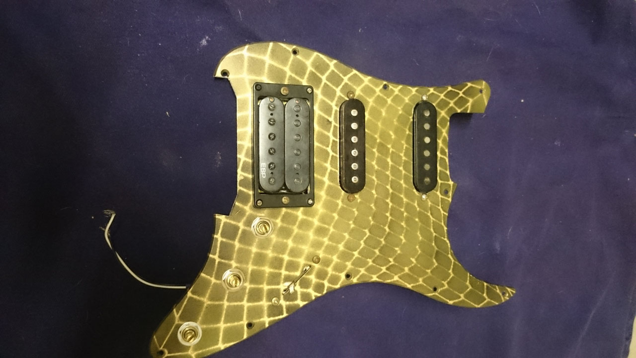 hight resolution of mark the holes and drill them out turn your pickguard over and mount the hardware solder your input jack and spring claw wires it s ready to screw into