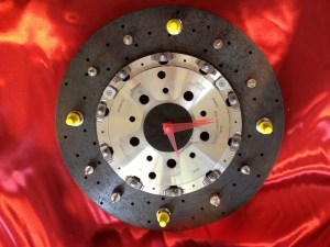 Working clock made from reused vehicle materials for Ferrari.