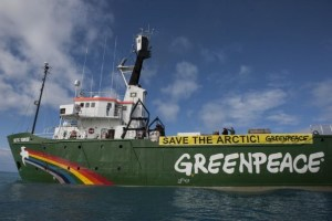 """Greenpeace's Arctic Sunrise and crew are confronting the seismic vessel in the Barents Sea north of Russia, protesting the Russian oil giant Rosneft as it prepares to drill for oil in the fragile Arctic. A banner reads """"Save the Arctic."""" Early this morning, as the Rosneft-contracted vessel Akademic Lazarev began firing underwater sound cannons up to 250 decibels in the Fedynskiy license block, Greenpeace approached the vessel, demanding that it stop operations immediately. Rosneft has recently signed joint deals to drill in the Arctic with international oil companies including ExxonMobil, BP and Statoil."""