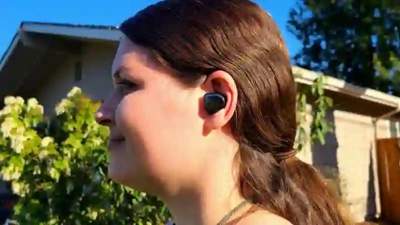 Master  Dynamic MW08 earbud listening